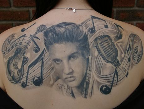 Famous People Portrait Tattoo On Upperback