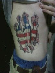 Fantastic American Flag Ripped Skin Tattoo On Rib Side