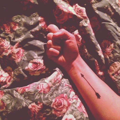 Fantastic Black Arrow Tattoo On Inner Wrist