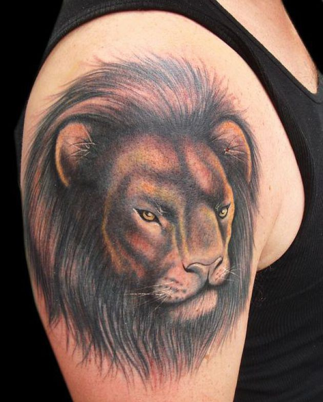 Fantastic Lion Face Tattoo On Biceps