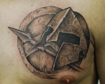 Fantastic Spartan's Helmet And Equipment Tattoos On Chest