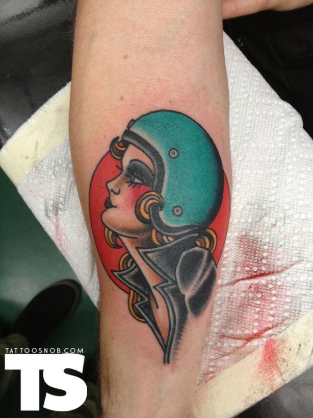 Female Head In Green Helmet Tattoo
