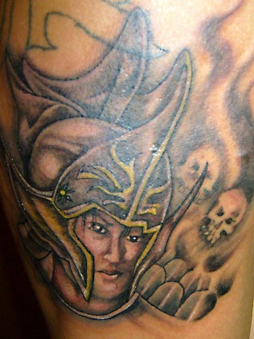 Female Head In Grey Helmet Tattoo