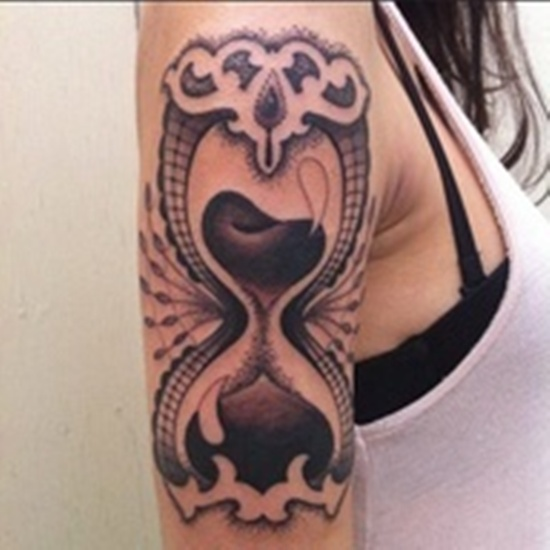 Feminine Hour Glass Tattoo On Biceps