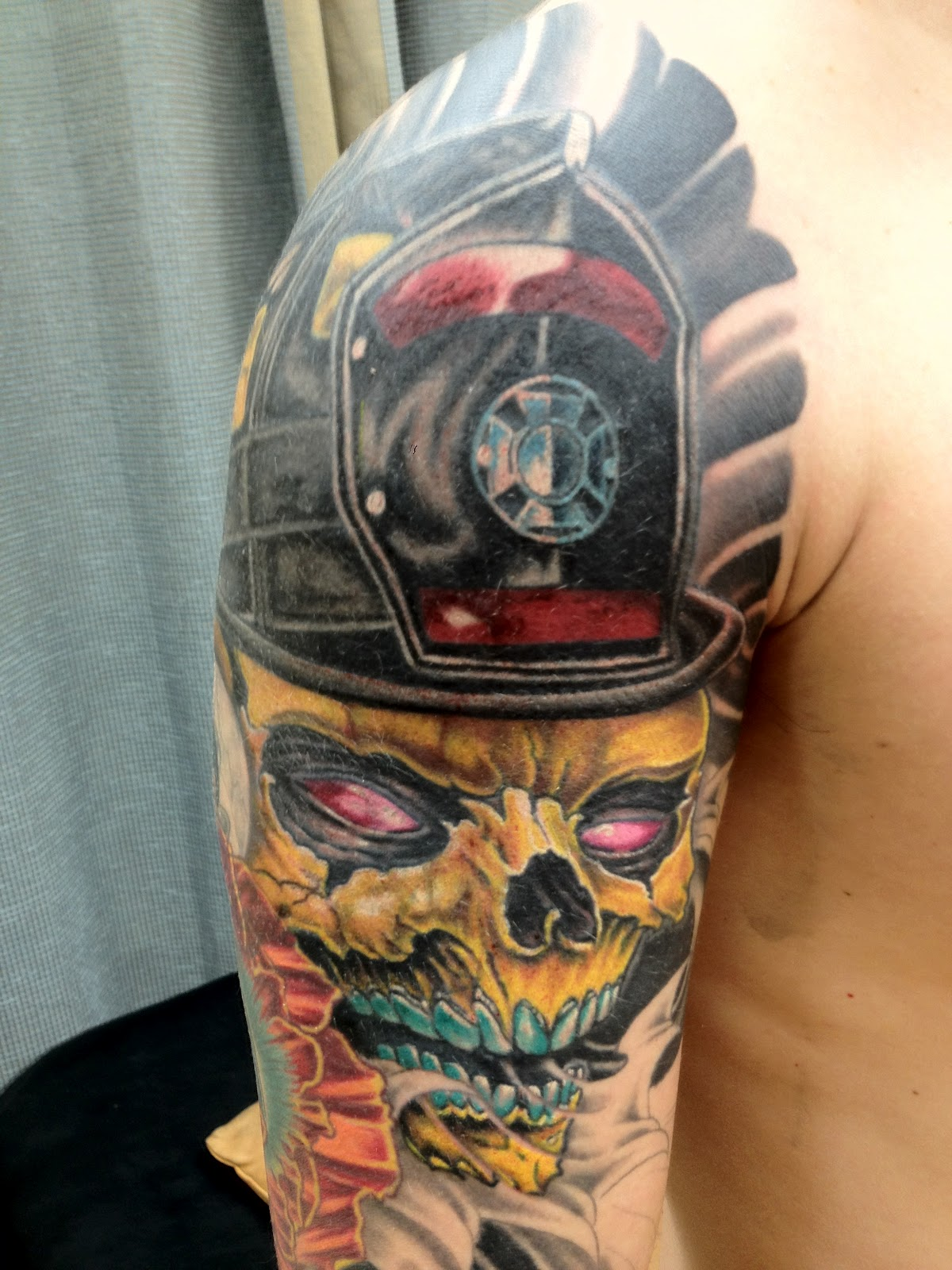 Firefighter Helmet And Skull Tattoos On Half Sleeve