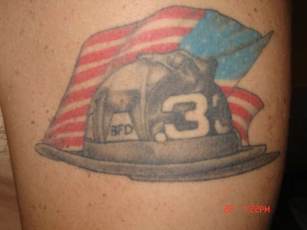 Firefighter Helmet And US Flag Tattoos