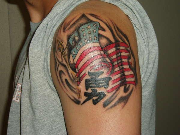 Flames And American Flag Tattoo On Shoulder