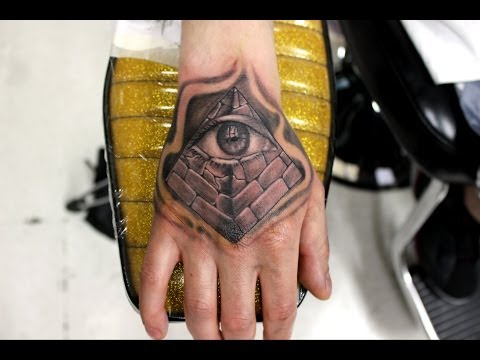 Flames And Eye Pyramid Tattoo On Hand