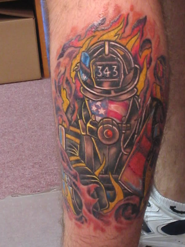 Flames And Firefighter Helmet Tattoos On Leg