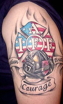 Flames And Firefighter's Helmet Tattoo On Biceps