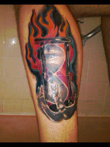 Flames And Hour Glass Tattoos