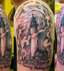 Flames And Lighthouse Tattoos On Shoulder