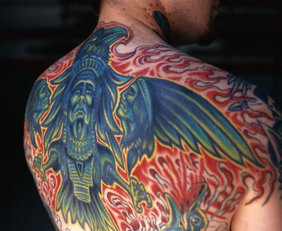 Flames And Native American Tattoos On Backbody