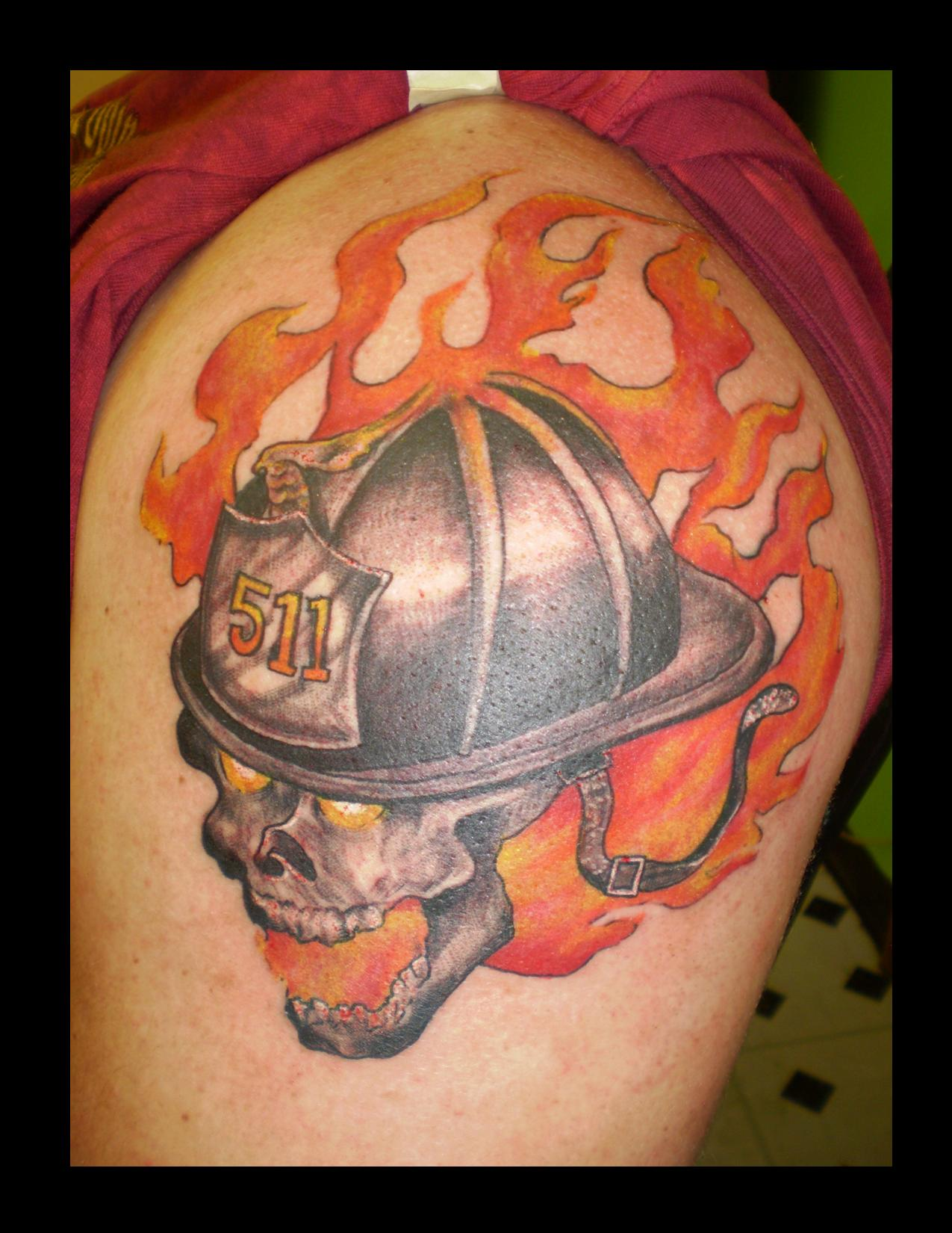 Flames And Skull Helmet Tattoos On Biceps