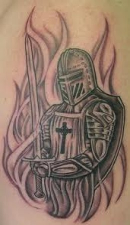 Flames And Warrior Wearing Helmet Tattoo