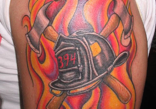 Flames Crossed Axe And Helmet Tattoos