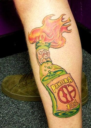 Flaming Pantera Bottle Tattoo On Leg