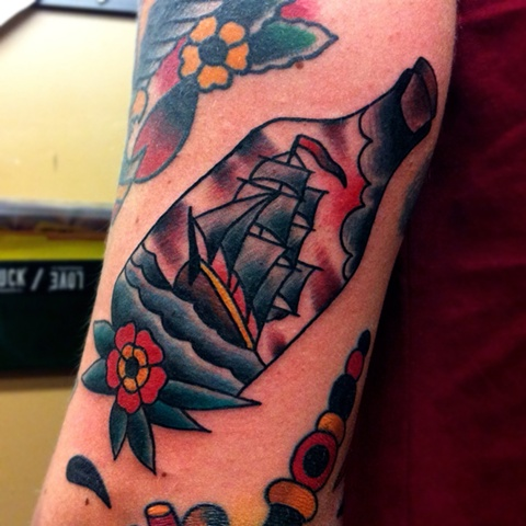 Flower And Bottle With Ship Tattoo