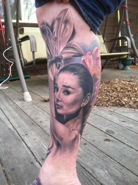 Flowers And Audrey Hepburn Portrait Tattoos On Leg