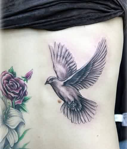 Flowers And Flying Pigeon Tattoos On Backbody