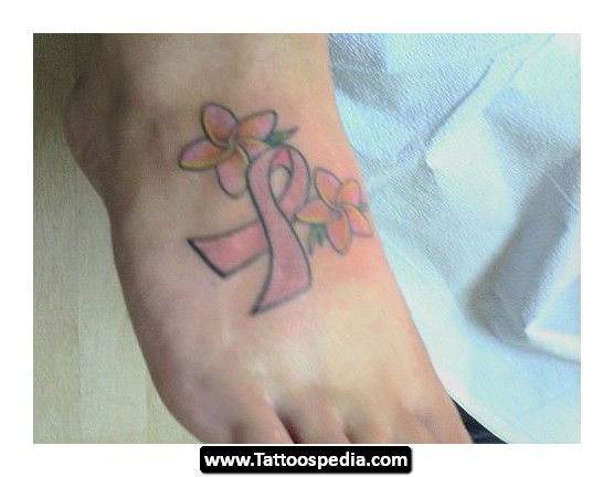 Flowers And Pink Ribbon Tattoos On Foot