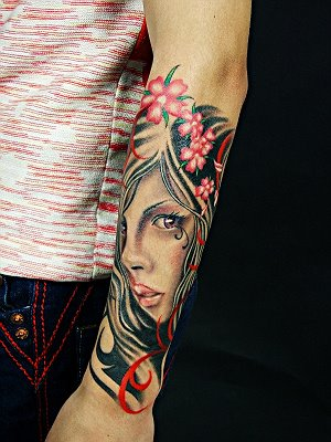 Flowers On Girl Portrait Tattoo On Lower Arm
