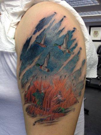 Flying Birds And Animal Tattoos On Biceps