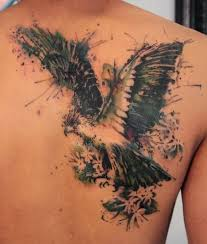 Flying Watercolor Bird Tattoo (2)