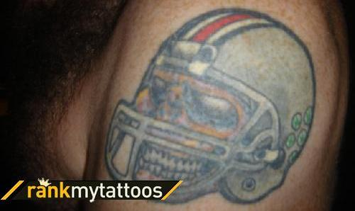 Football Helmet Tattoo On Biceps
