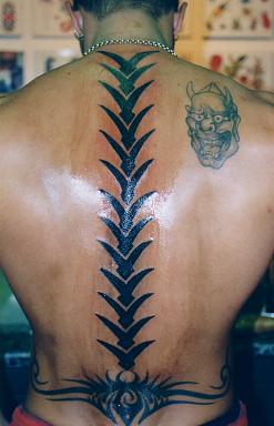Fresh Tribal Spine Bone Tattoo For Men