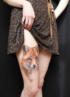 Girl Shows Off Her Animal Tattoo On Right Thigh