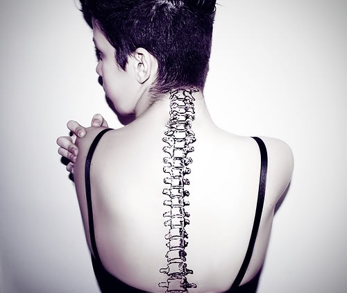 Girl With Spine Bone Tattoo