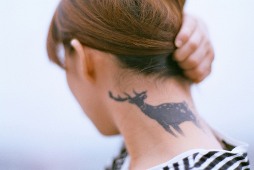Girls Shows Off Her Back Neck Animal Tattoo