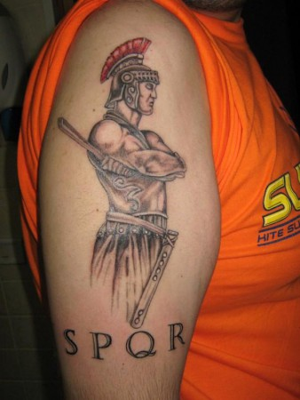 Gladiator Wearing Helmet Tattoo On Biceps