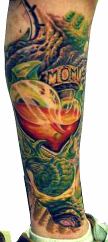 Glass Heart And Dragon Tattoos On Leg