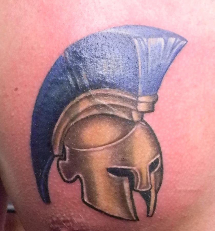 Golden Helmet With Blue Hairs Tattoo On Chest