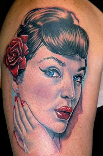 Gorgeous Blue Eyed Pin Up Portrait Tattoo On Biceps