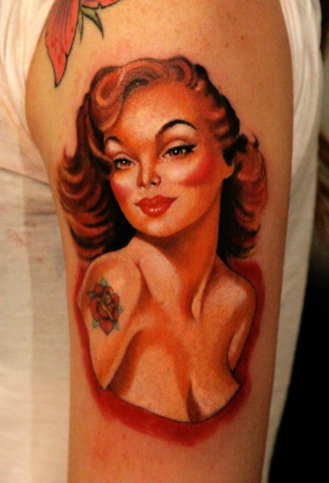 Gorgeous Female Portrait Tattoo On Biceps