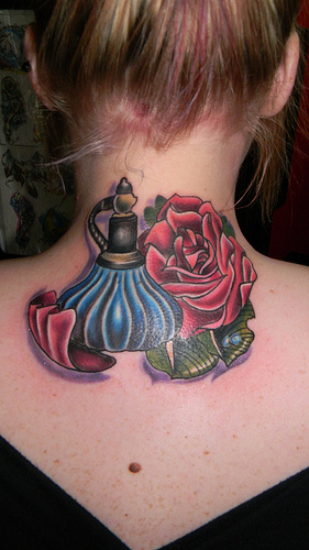 Gorgeous Perfume Bottle And Rose Tattoos On Back Neck