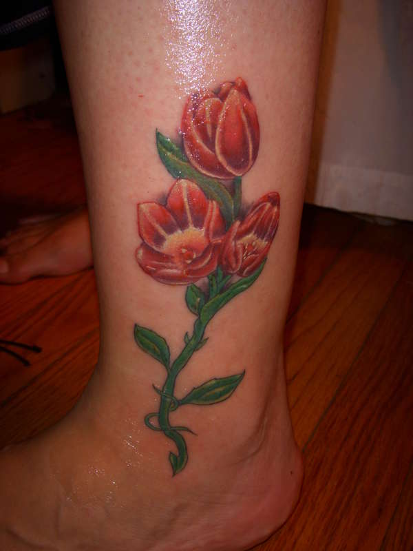 Gorgeous Red Tulips Tattoos On Ankle For Girls