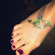 Gorgeous Watercolor Bird Tattoo On Foot