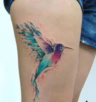 Gorgeous Watercolor Bird Tattoo On Thigh