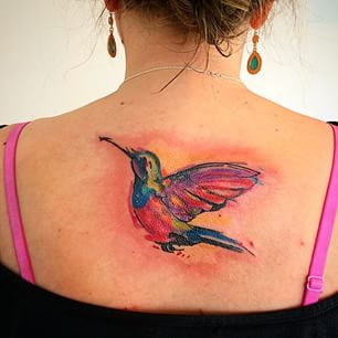 Gorgeous Watercolor Bird Tattoo On Upperback