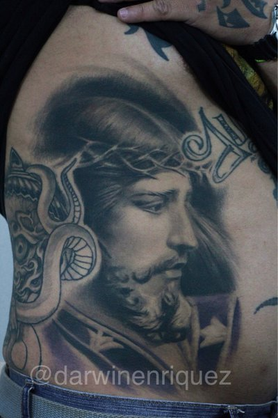 Great Barbed Jesus Portrait Tattoo On Ribs