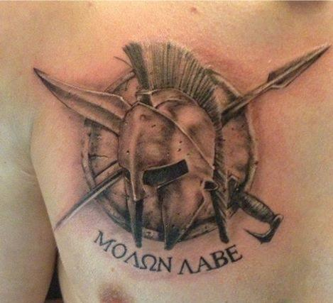 Greek Helmet Shield And Weapon Tattoos On Chest