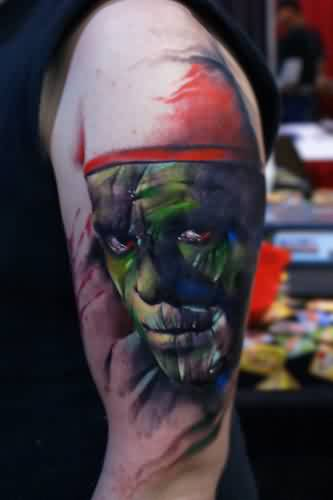 Green Ink Mummy Face Portrait Tattoo On Biceps