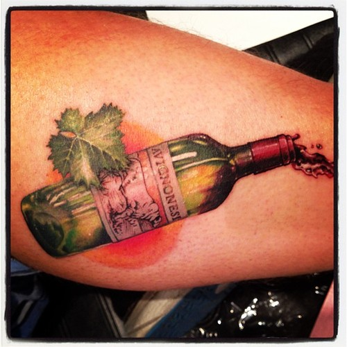 Green Leaf And Wine Bottle Portrait Tattoos