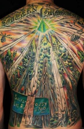 Green Lightning Pyramid Tattoo On Upperback