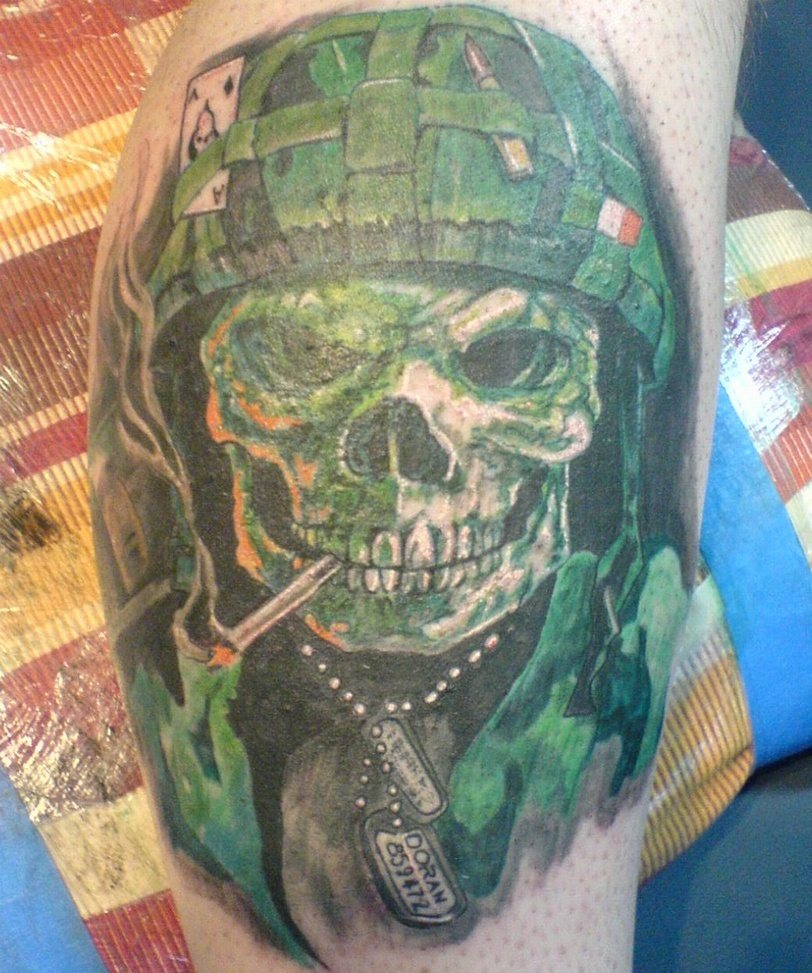 Green Smoking Skull And Helmet Tattoos