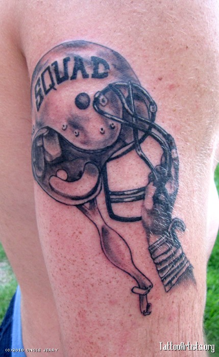 Grey Helmet In Hand Tattoo On Biceps